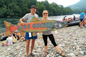 Blue Heart Team (Ulrich Eichelmann and Cornelia Wieser from Riverwatch) at the Drina Regatta, protesting dam projects in the name of the threatened Huchen.