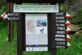 Info board in Mavrovo National Park, containing information about Mount Korab and directions to villages.