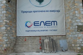 """ELEM's (Macedonian Energy Group) banner at the hydro power plant on Mavrovo Lake. It suggests that the hydropower plant would generate """"green energy"""". Photo Petr Hlobil."""