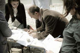 Participants signing attendance list.