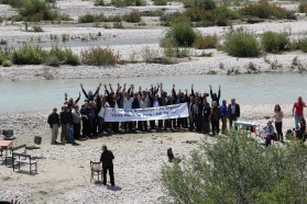 Participants of the press conference at the Vjosa River demonstrate their opposition against the planned dam projects and demand a Vjosa National Park.