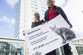 Protest in front of World Bank Country Unit in Vienna. Representatives of Riverwatch (Cornelia Wieser and Ulrich Eichelmann) hand over 77,930 signatures against the planned funding of a hydroelectric dam in the Mavrovo National Park in Macedonia.